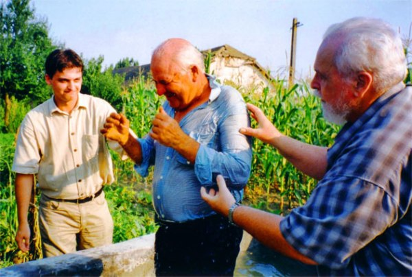 Another baptism in a vegetable garden, Filiasi